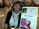 Jacqueline T. Moore signing at the Dayton International Airport